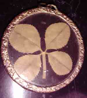 This image has an empty alt attribute; its file name is jewelry-clover-pendant.jpg