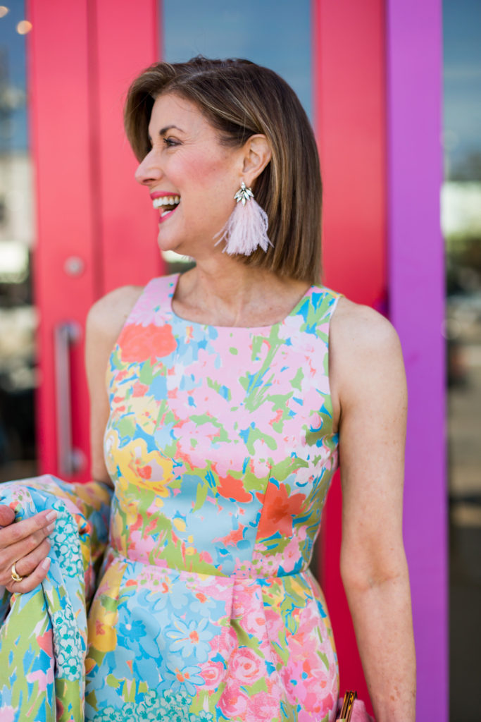 Debby Allbright Fashionomics wearing Boutique Moschino dress and Auden feather earrings