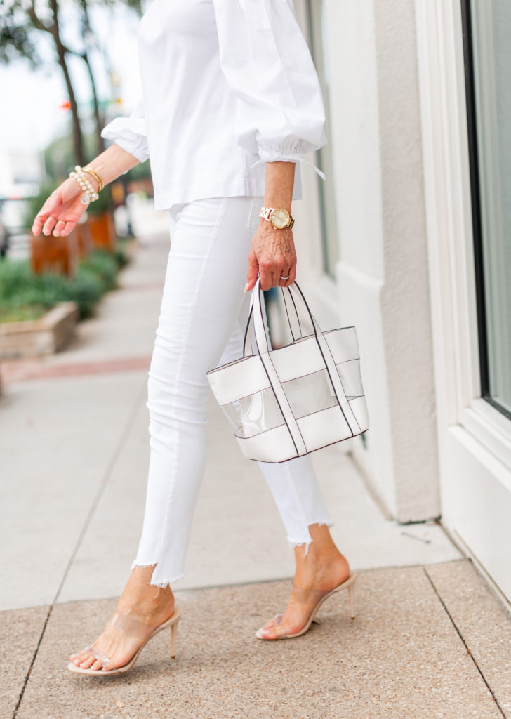 clear shoes and clear bag with white jeans