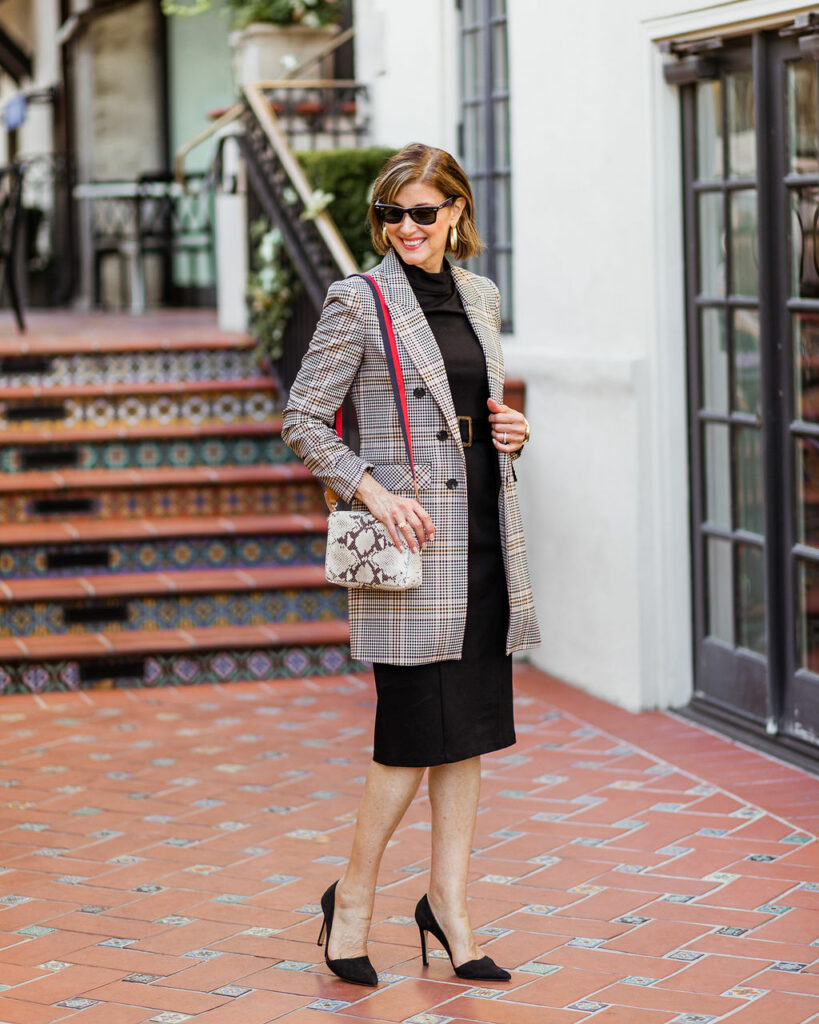 Snakeskin Claire V cross body bag on Fashionomics founder