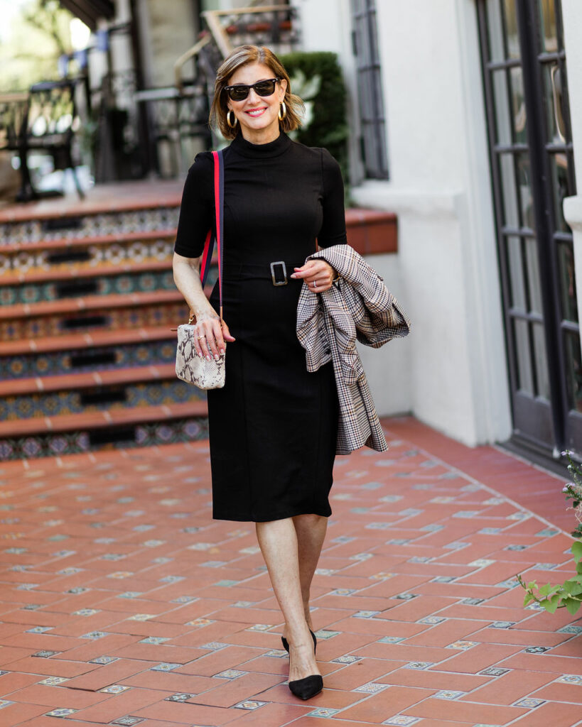 Basic black dress with snakeskin bag and plaid jacket