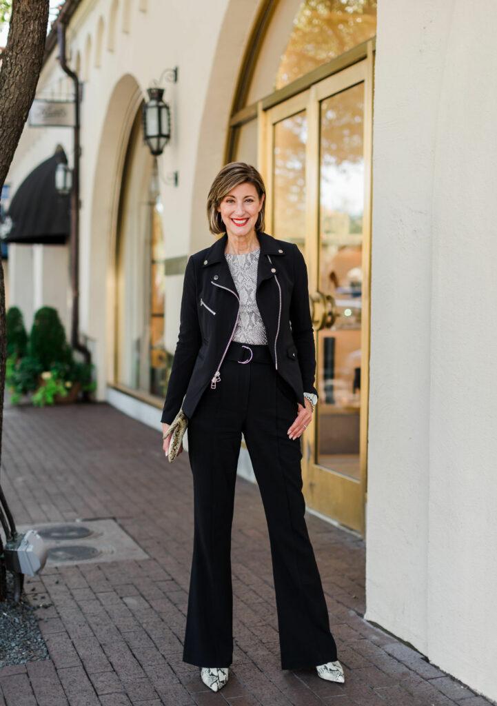 Dallas Blogger in black zipper jacket with snakeskin top