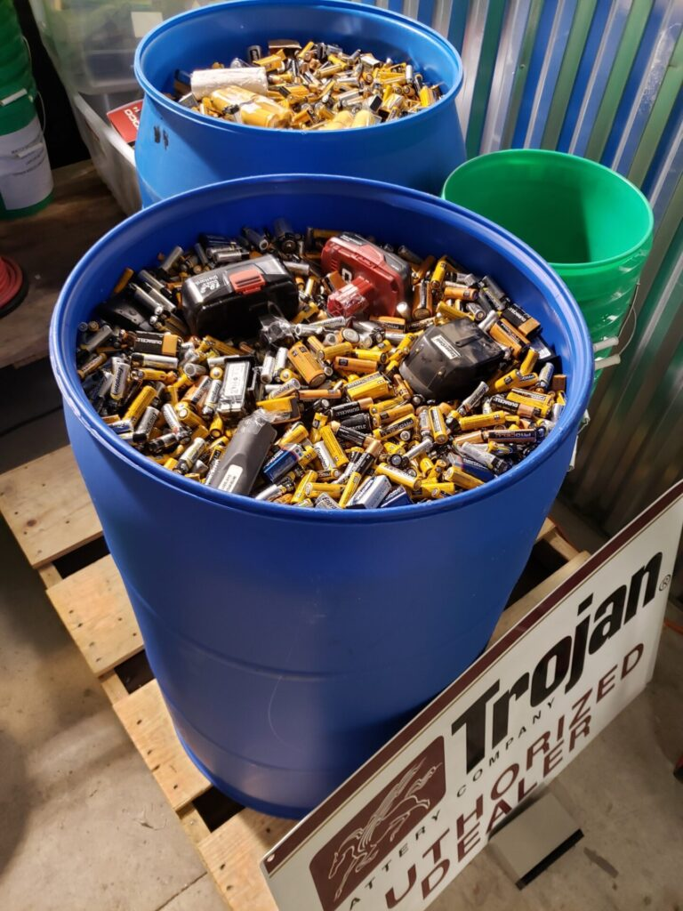 Two barrels filled with batteries for recycling