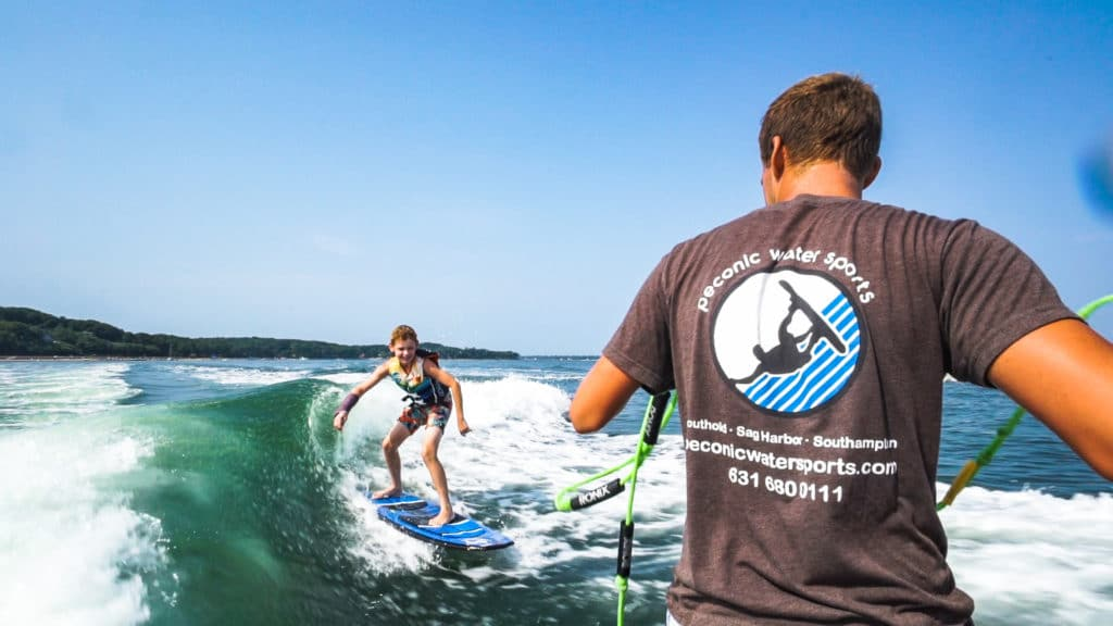 Wakesurfing in Montauk with Peconic Water Sports on a Malibu Wakeboard Boat