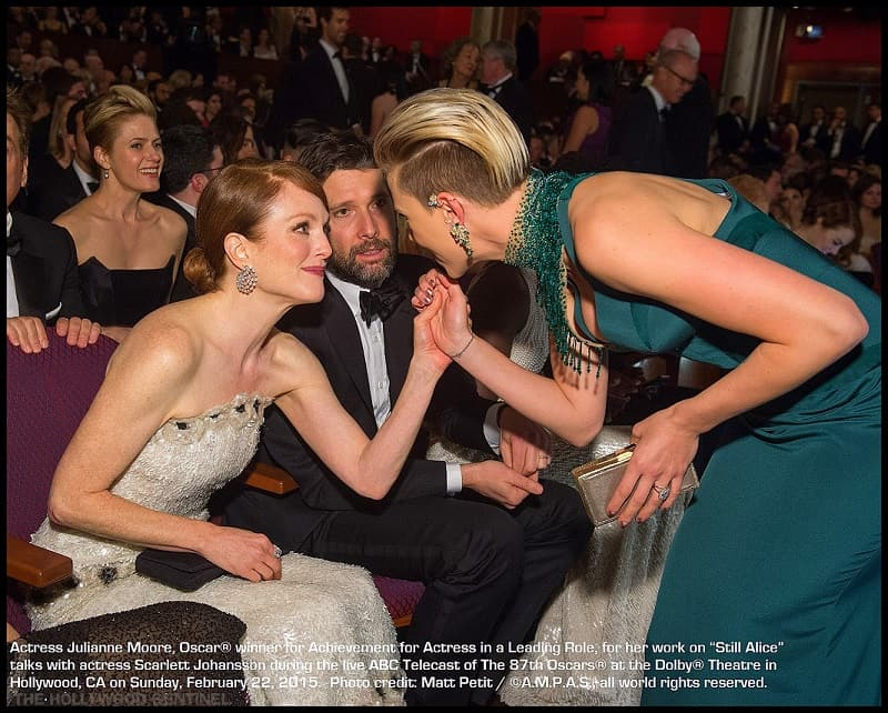 """Julianne Moore, Oscar® nominee for Achievement for Actress in a Leading Role, for work on """"Still Alice"""" interacts Scarlett Johansson during the live ABC Telecast of The 87th Oscars® at the Dolby® Theatre in Hollywood, CA on Sunday, February 22, 2015."""