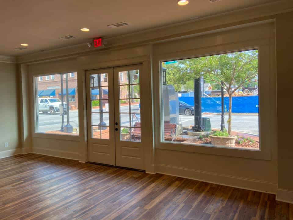Photo from the inside of the storefront toward the street showing the store entrance and new windows.