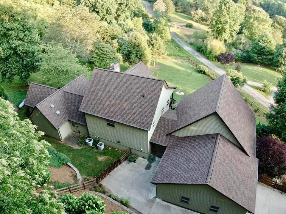 Aerial photo of home that just had a full replacement roof installed.