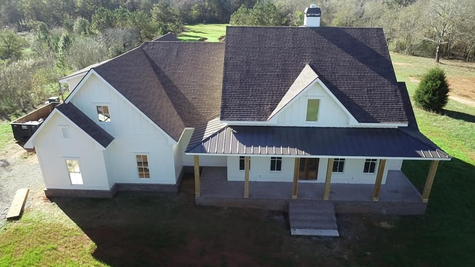 aerial view of the front of the Boone House showing roofline, front porch and entrance, garage wing and bump out