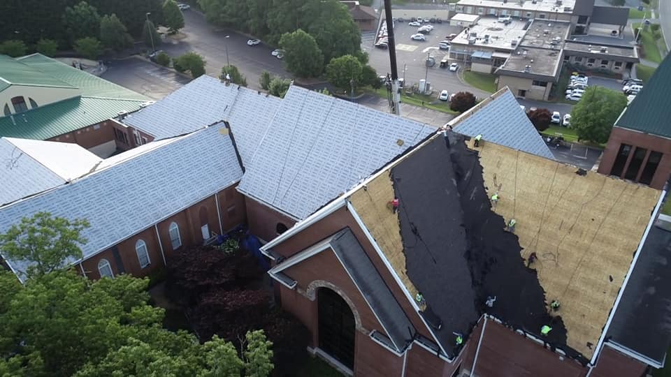 aerial photo of team working on roof removal