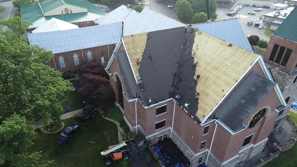 aerial photo of Ridgeline team removing large section of old roof materials.