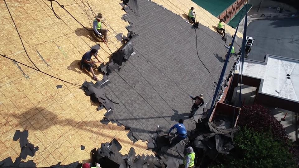 aerial of Ridgeline team removing old asphalt tiles