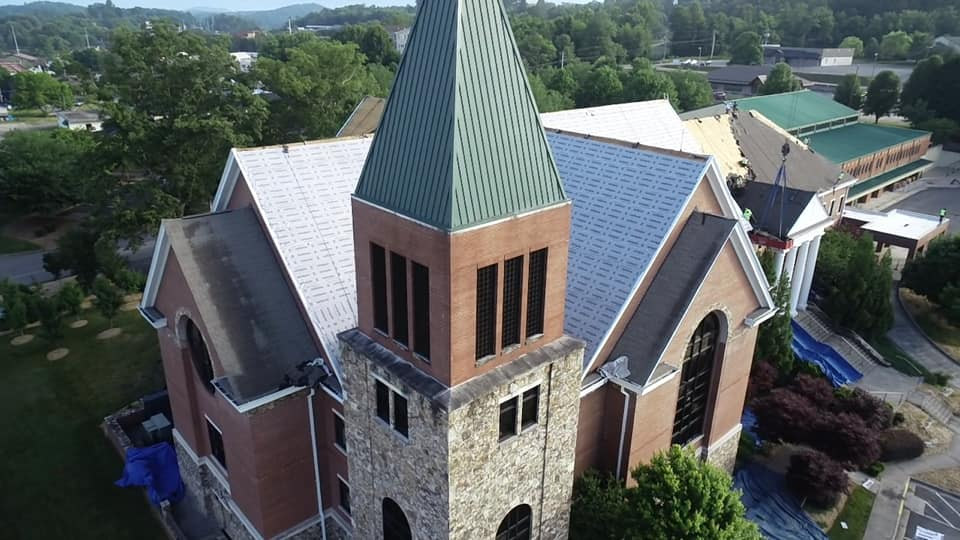 Wide view of roof system and bell tower