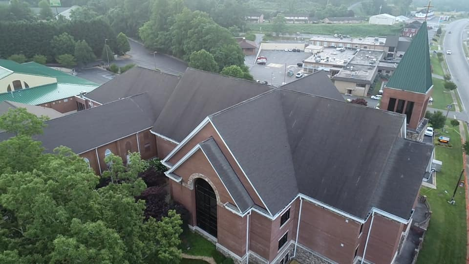 aerial photo of the damaged roof prior to replacement at McConnell Memorial Baptist Church