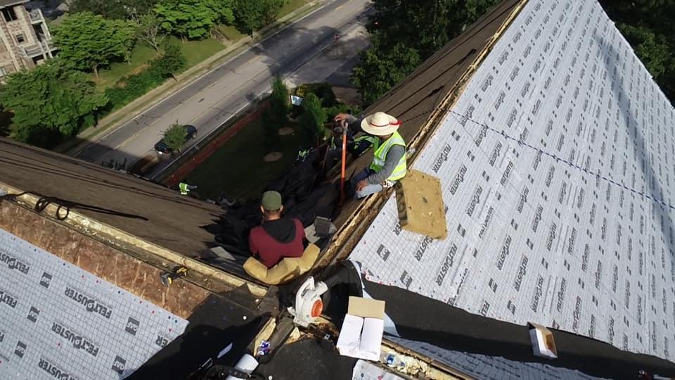 aerial photo of Ridgeline team installing new underlay at the peak