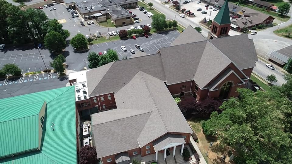 wide aerial view of newly completed roof.