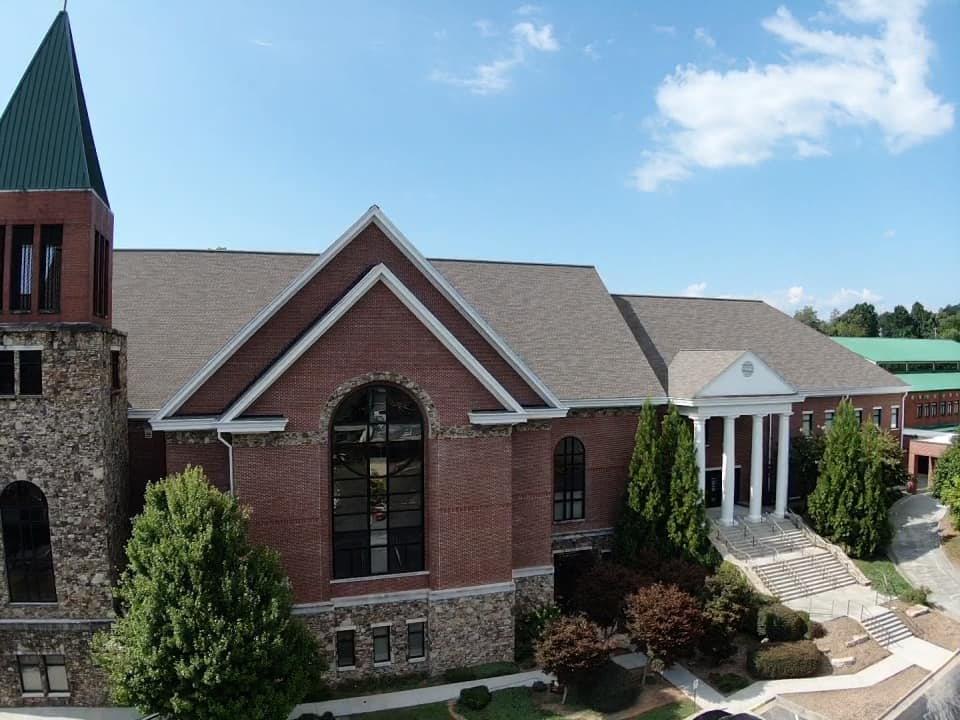 Photo of new roof from front of church and bell tower.