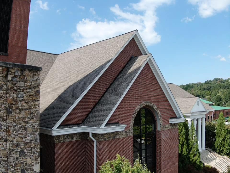 closer view of new roof with double pitch roof dormer over sanctuary window