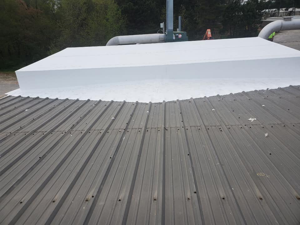 photo of side view of the wrapped equipment on the metal roof