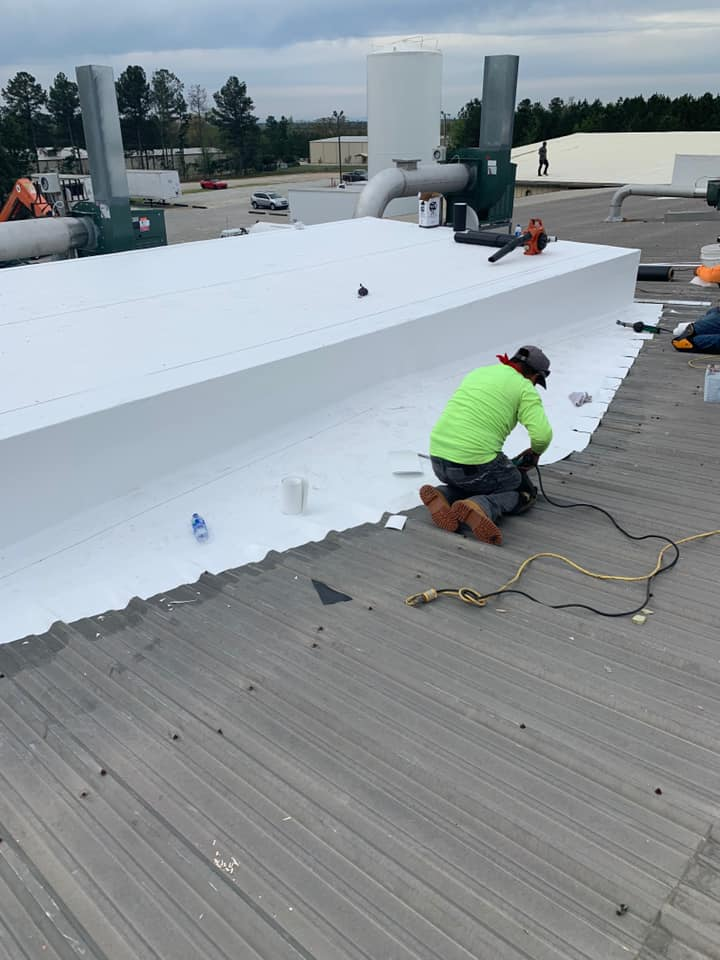 photo of Ridgeline Roofing team installing the seals and wrap for the roof cover