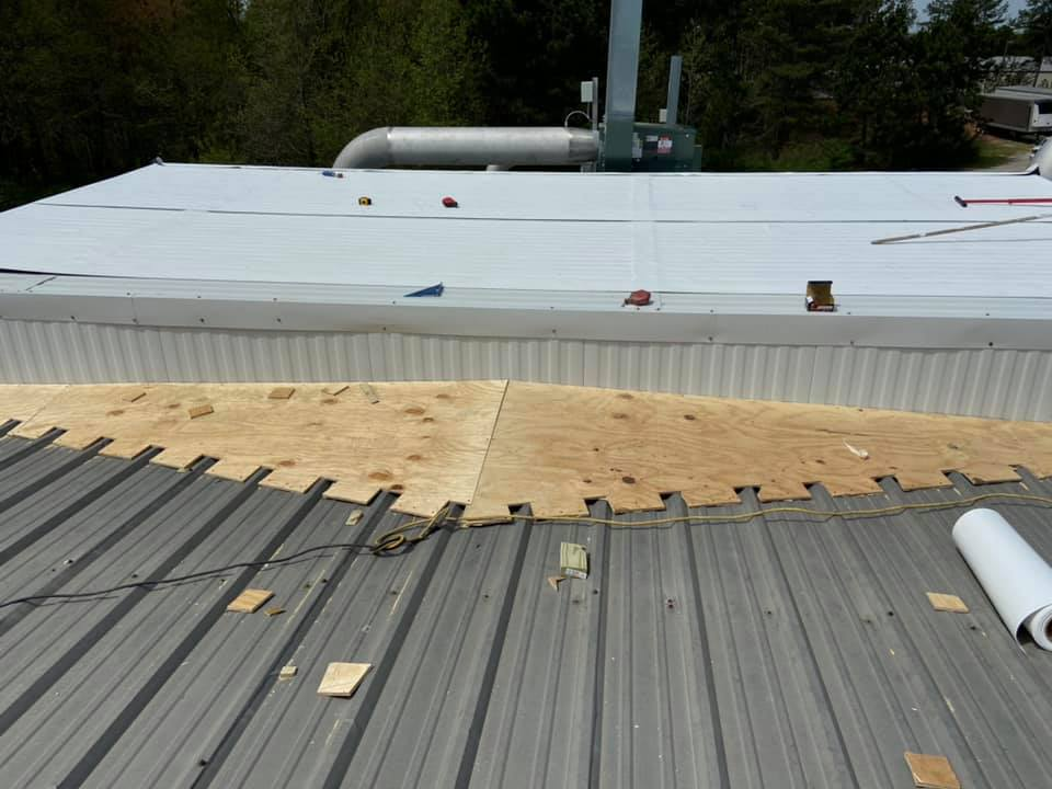 photo of new slope line being constructed for flat metal roof