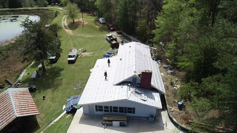 aerial view of the Ridgeline Roofing team installing the underlay roofing system for the metal roof.