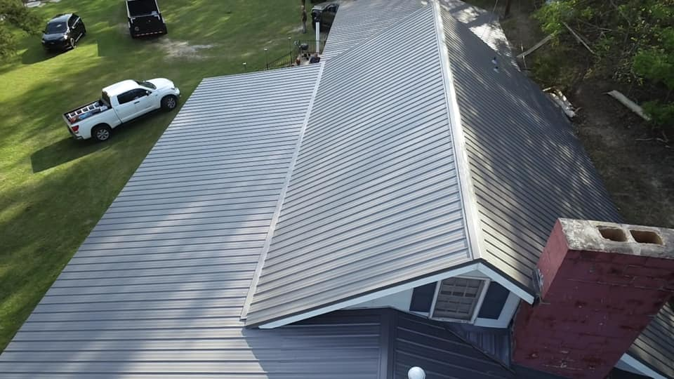 closer aerial view of the gray metal roof installation
