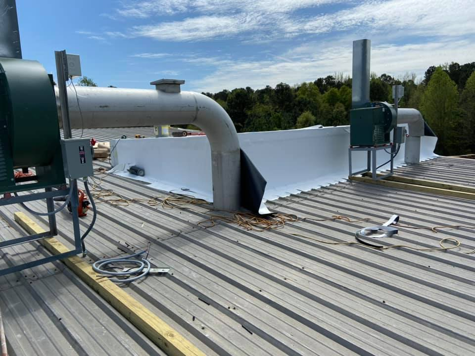 Photo of the new equipment installed on the plant's roof that left gaps in the metal roofing