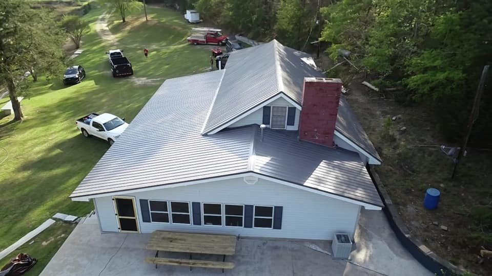aerial photo of metal roof showing upper dormer, chimney flashing and roof pitch