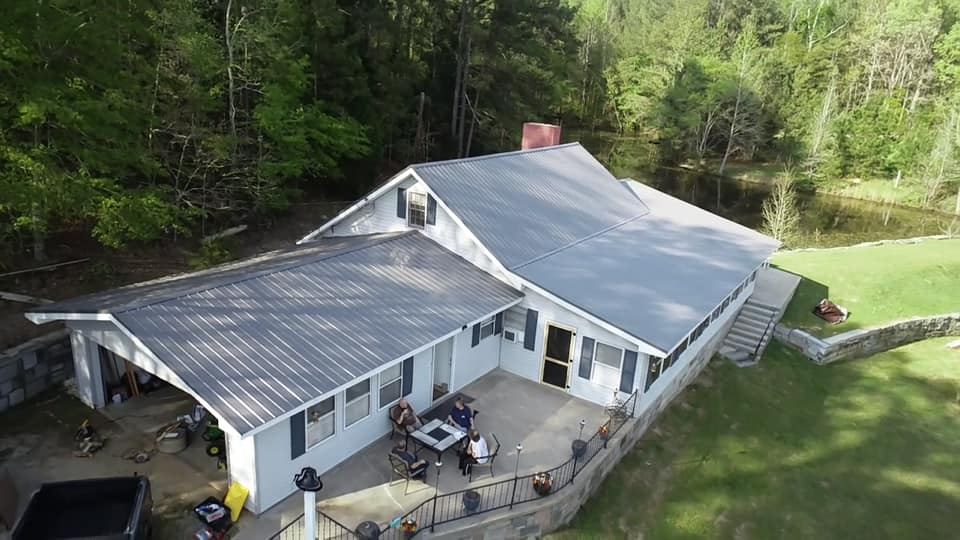 aerial of newly installed metal roof on a residential building