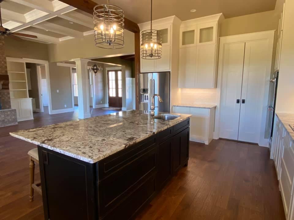Photo of granite island in chef's kitchen at Boone House in Oconee, GA