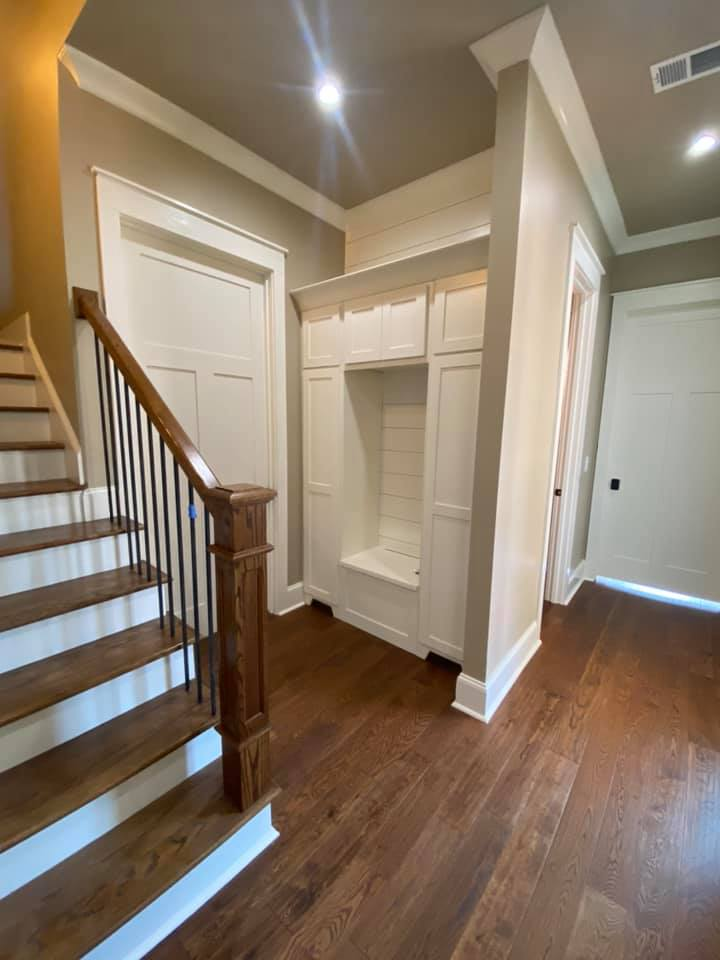 Photo of mudroom storage built ins and staircase to 2nd floor