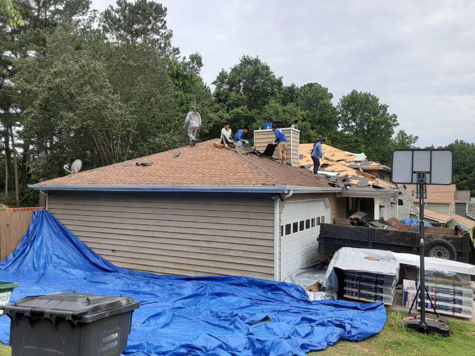 mature landscaping is protected during the roof replacement process