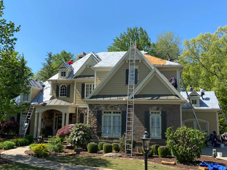 Front view of Cumming home undergoing roof replacement