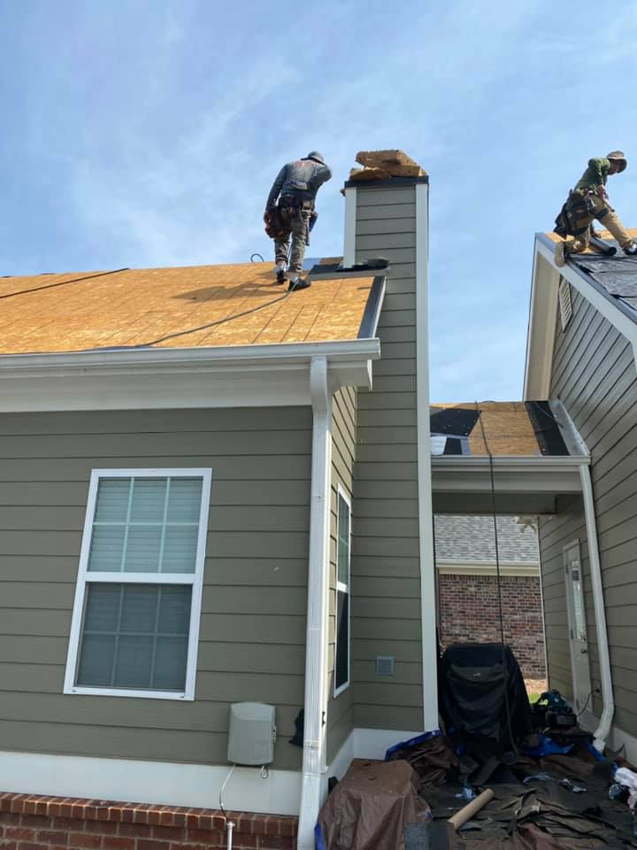 Photo of Ridgeline crew getting the decking ready for a new roof on the Bogart House