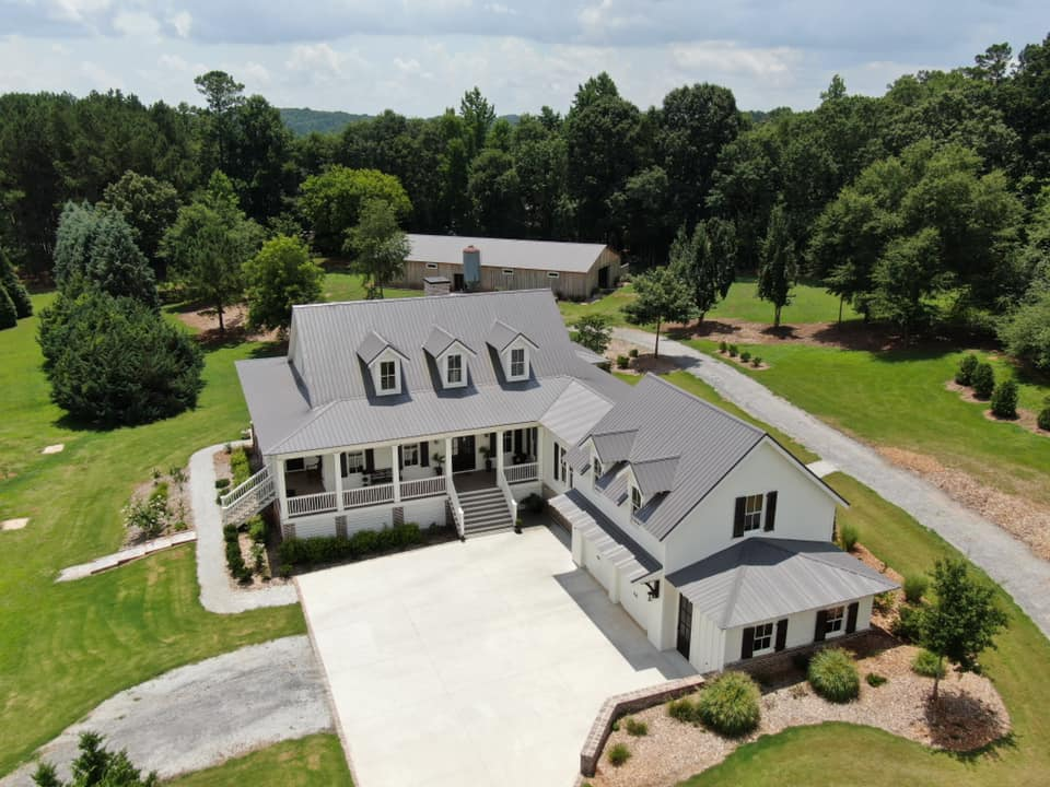 aerial photo of roof view from the entrance drive area to the home