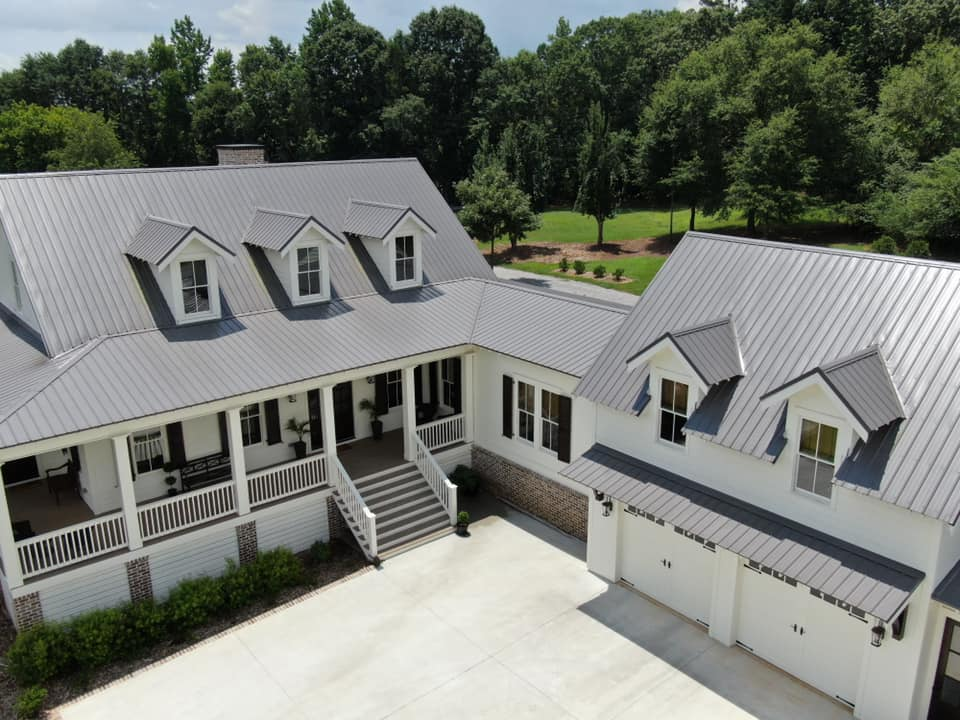 aerial photo of the entrance to the home and the breezeway with dormers of the garage