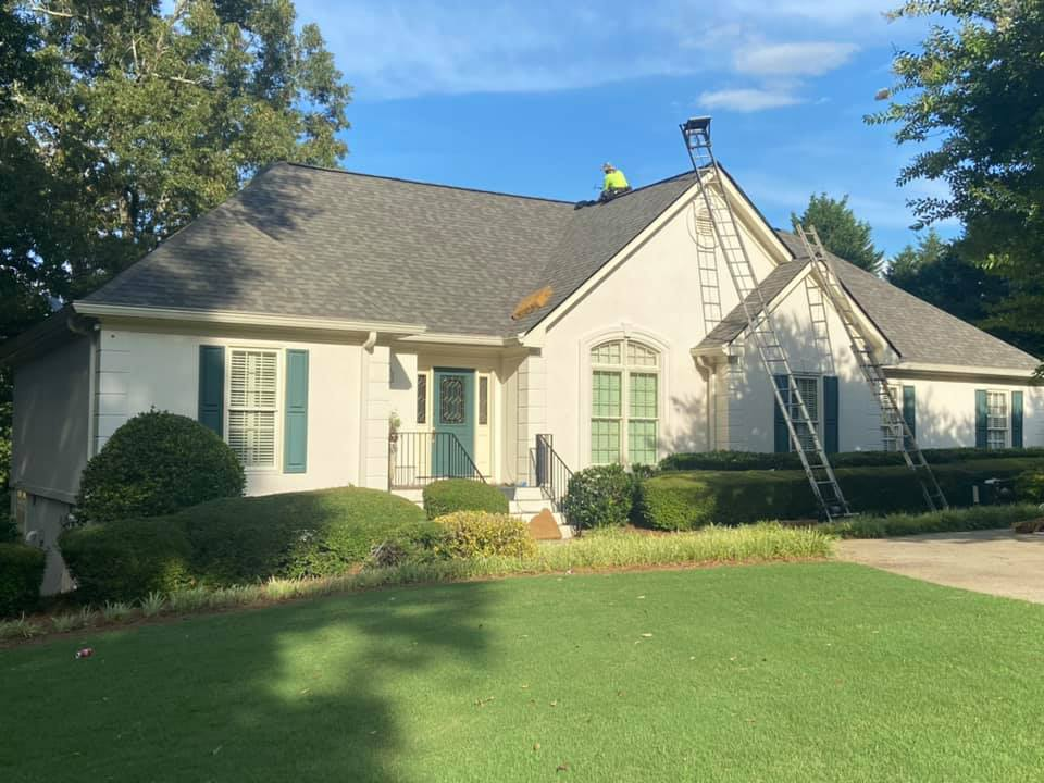 final touches on the new roof at the Watkinsville home