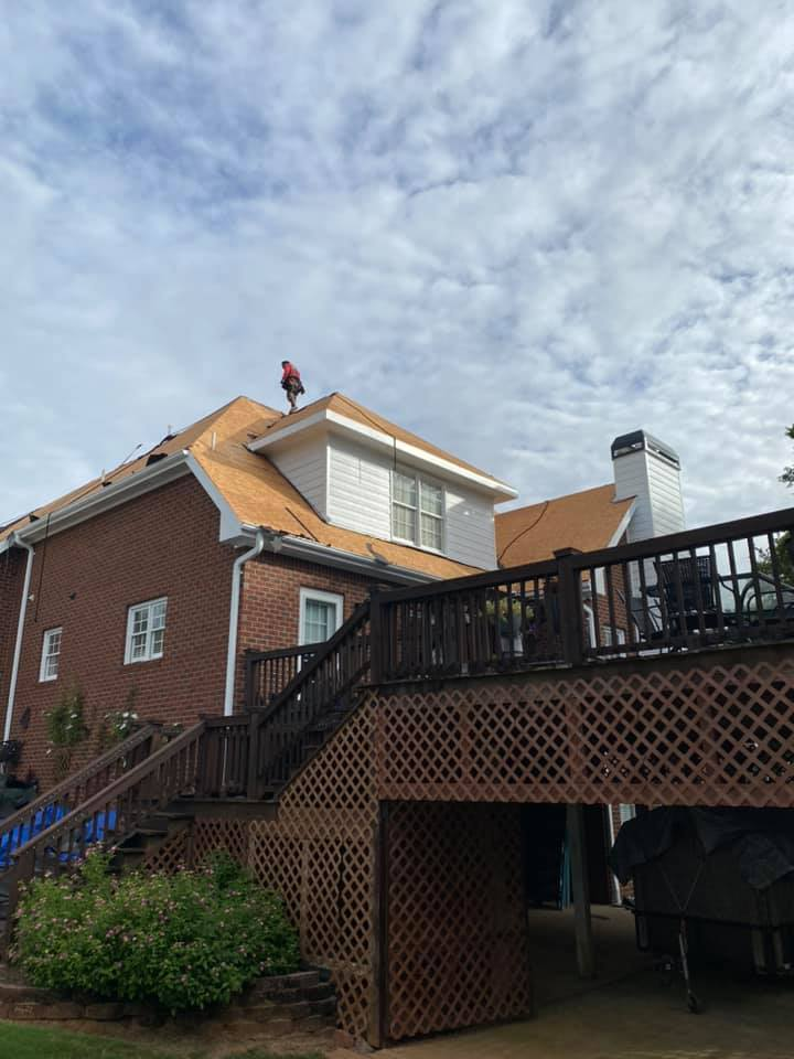 photo of Watkinsville home with workers starting work on the dormers