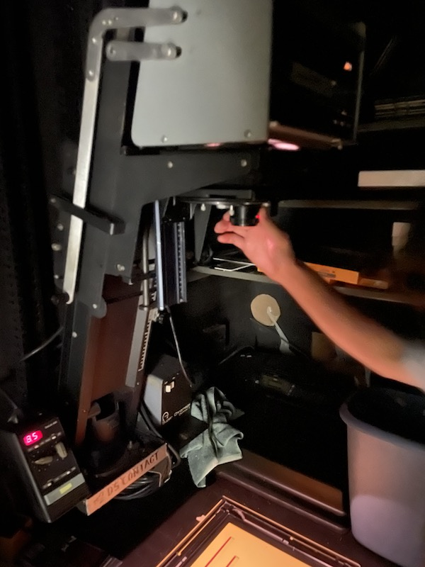 Person using the Super Chromega D enlarger in the color darkoom