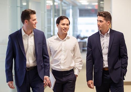 Brookside team members walking and talking in the hallway