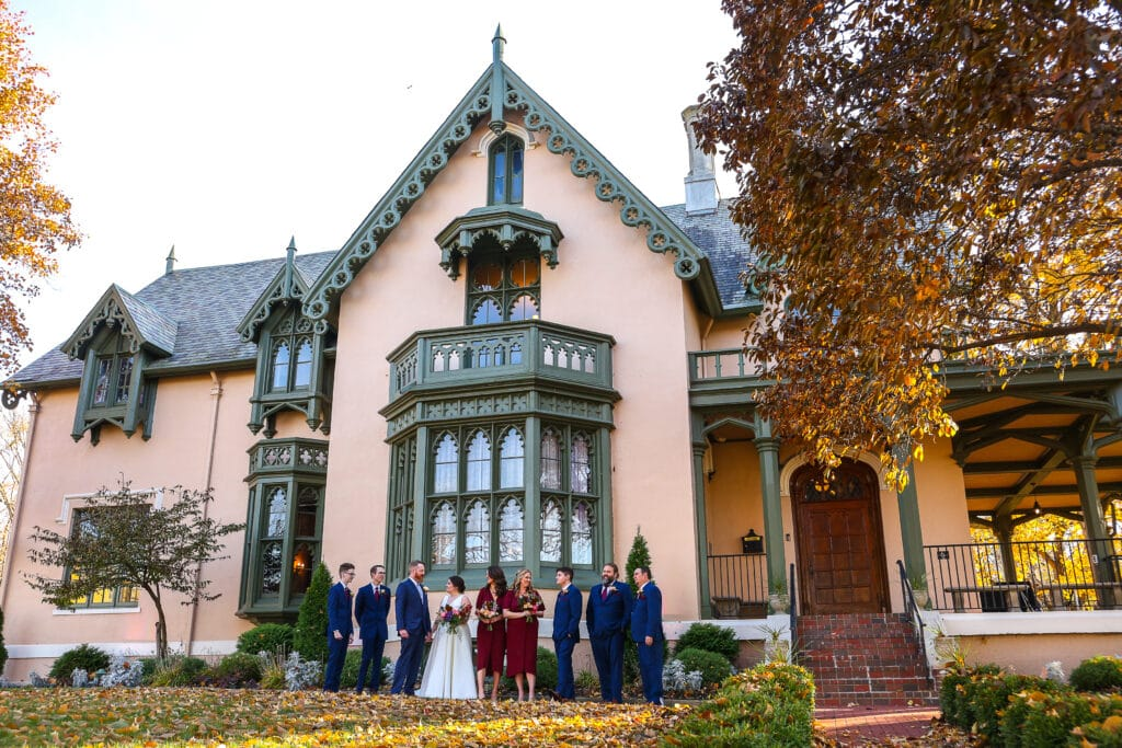 Bridal party outside Fowler House Mansion on a fall day
