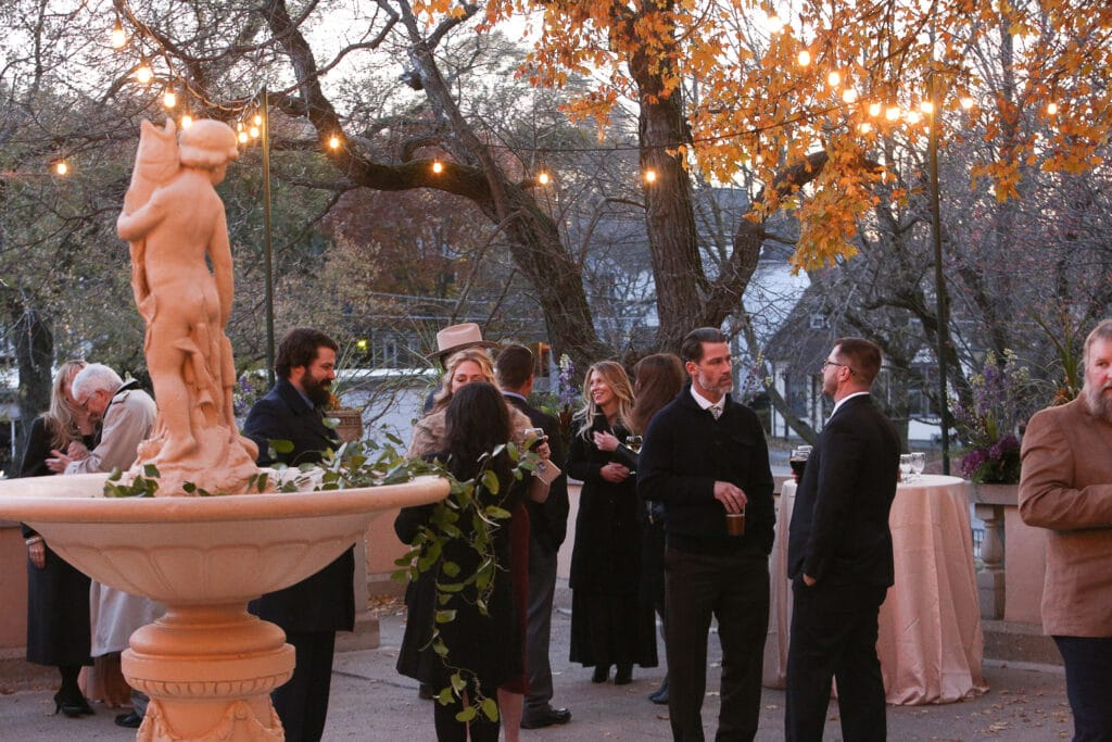 guests mingling during fall cocktail hour at fowler house mansion