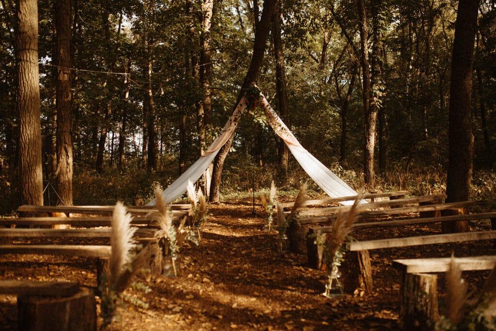 Woodland outdoor wedding ceremony in Indiana