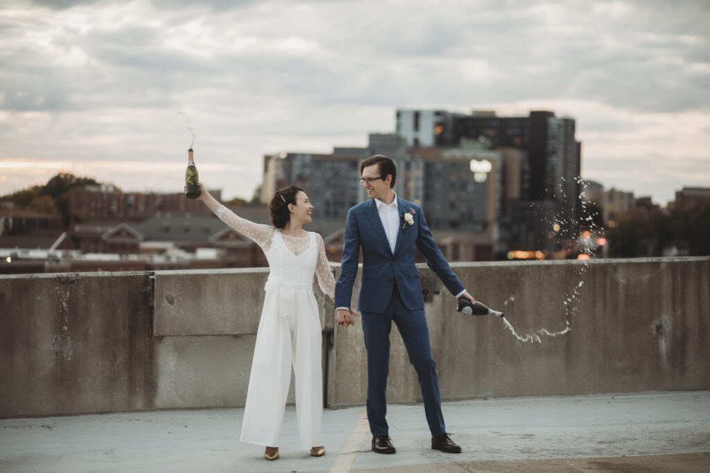bride and groom celebrating their modern midwest elopement with champagne