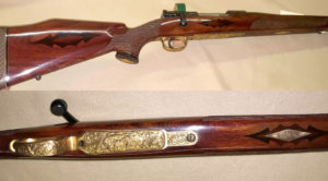 Early FN .300 custom. Engraved barrel and receiver as standard. Gold bottom metal with a whitetail deer. Very rare piece from the 50's. $POR