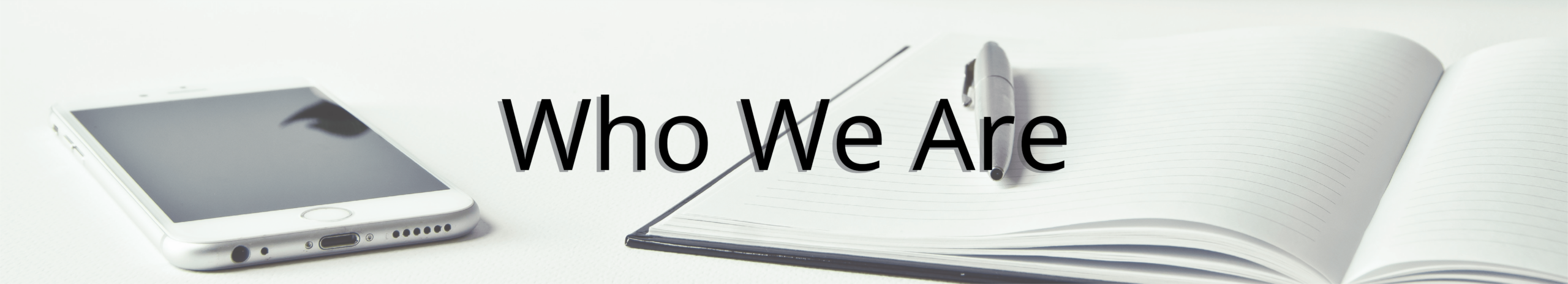 Who is The Staffing Center? Header - Image of an iPhone with a notebook laid on a table with the words Who We Are overlaid on top.