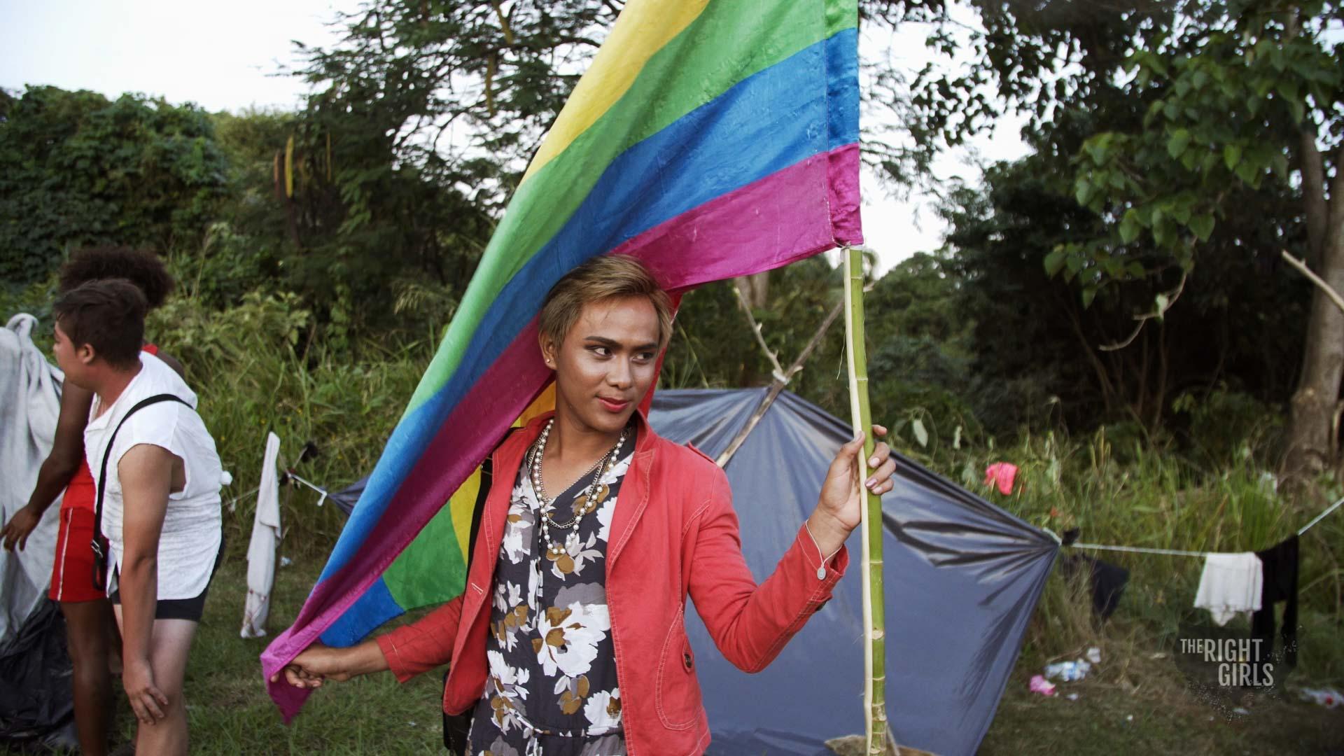 Valentyna posing with LGBTQ flag.