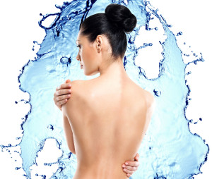 Beautiful female back over water splash background. Back view portrait