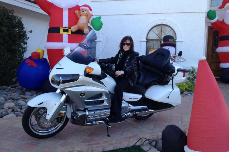 Daisy Monzo in 2012 on her motorcycle