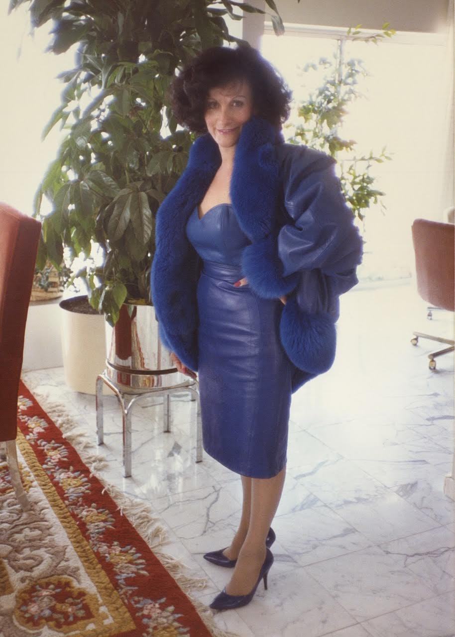 Daisy Monzo in a blue dress